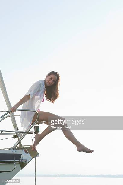 Girl sitting on front of boat