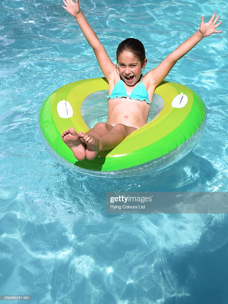 Free Swimming Pool: Girl Sitting On Inflatable In Swimming Pool Arms Raised