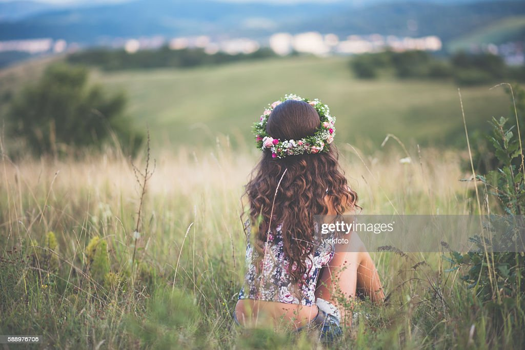 Girl sitting on nature : Stock Photo