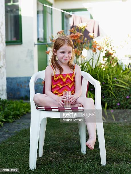Girl sitting on plastic chair