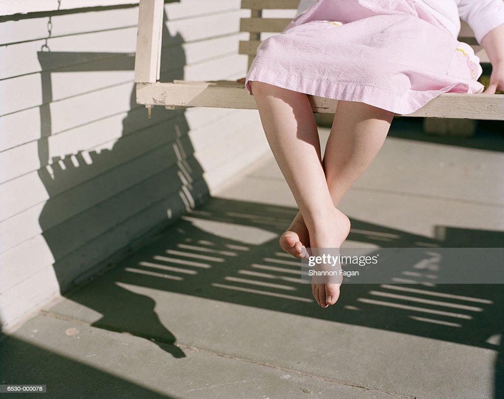 Girl Sitting on Porch Swing : Stock Photo