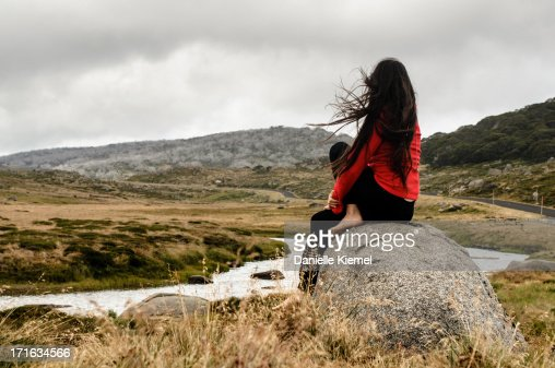 Image result for girl sitting on a rock