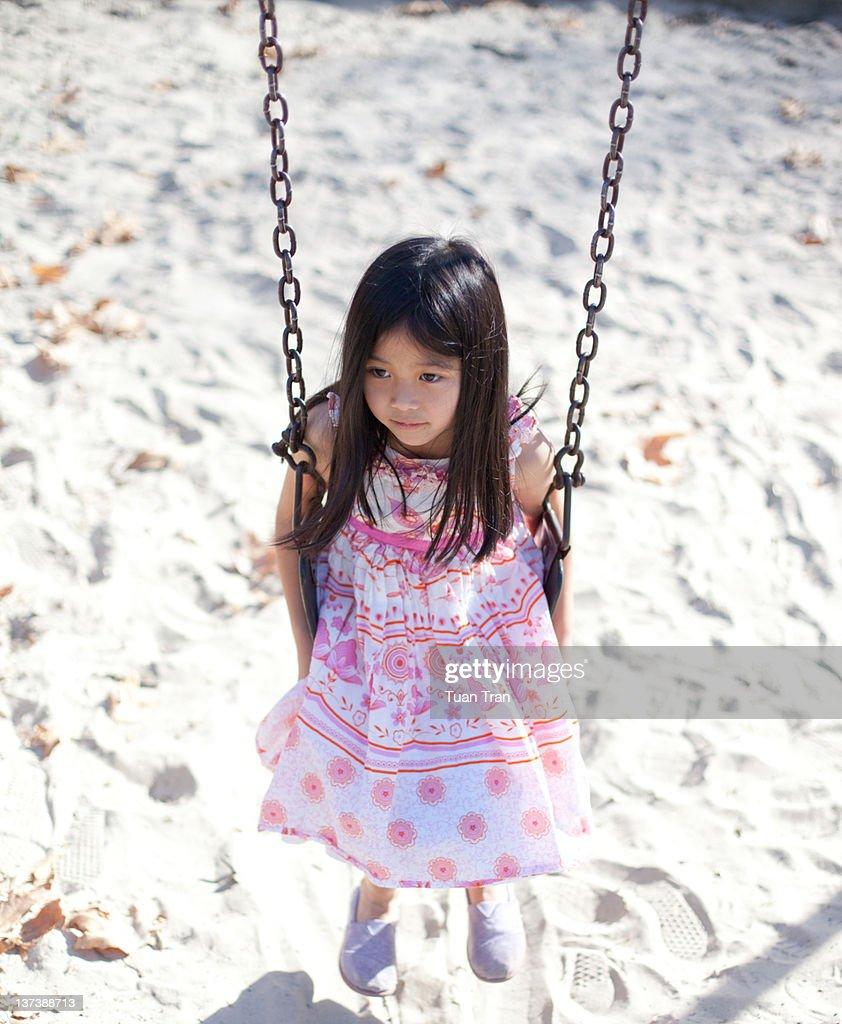 Girl sitting on swing : Stock Photo