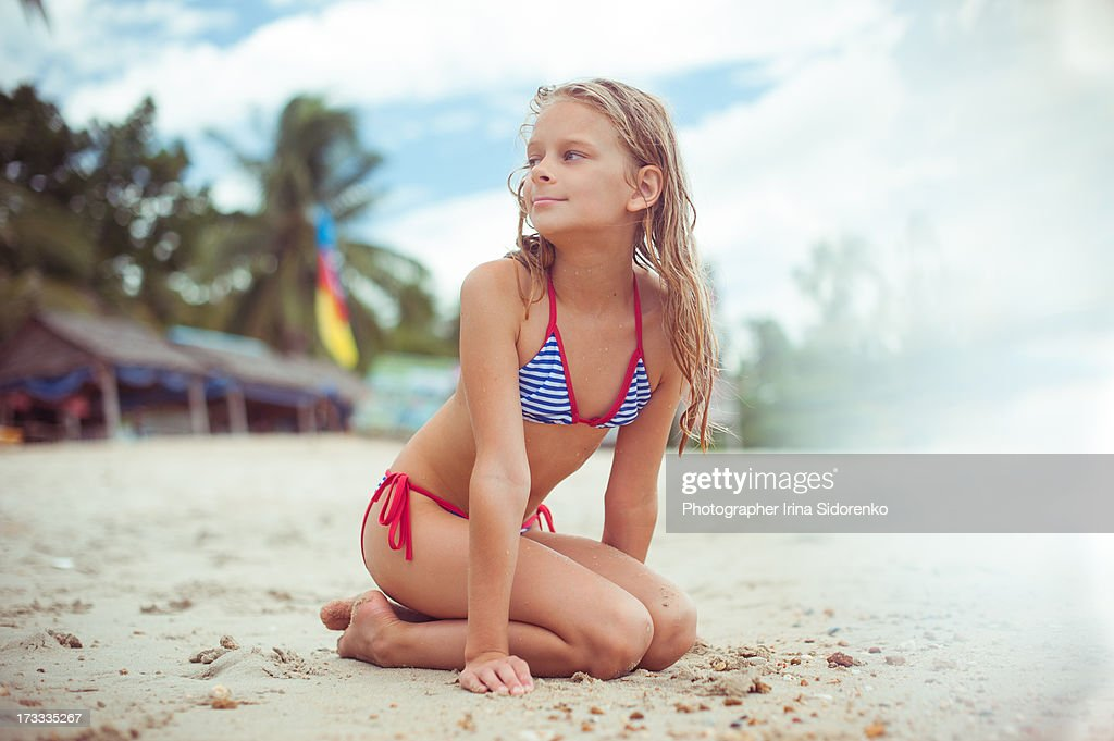 Girl Sitting On The Beach Stock Photo | Getty Images