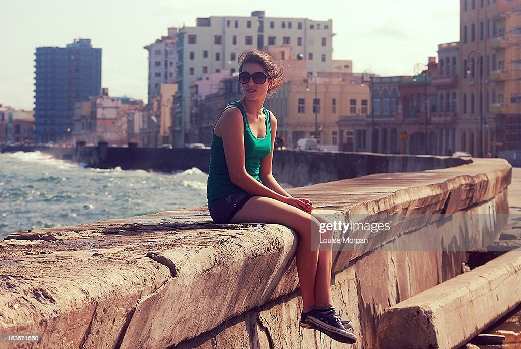 Girl sitting on the sea wall