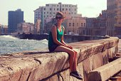 Girl sitting on the sea wall