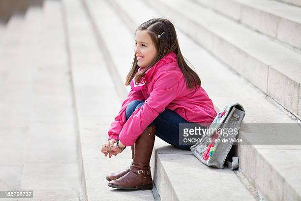 Girl sitting on the steps and smiling
