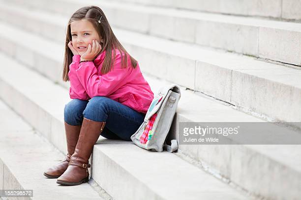Girl sitting on the steps and thinking