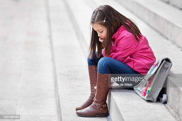 Girl sitting on the steps