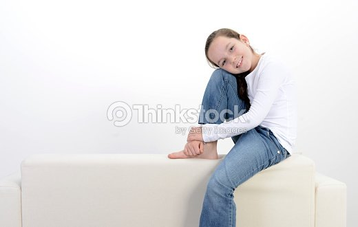 girl sitting on top of boy