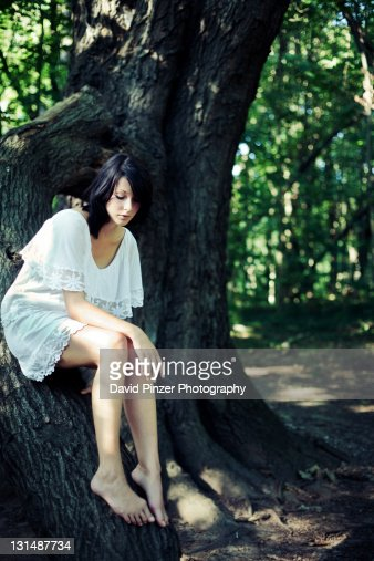 Girl sitting on tree
