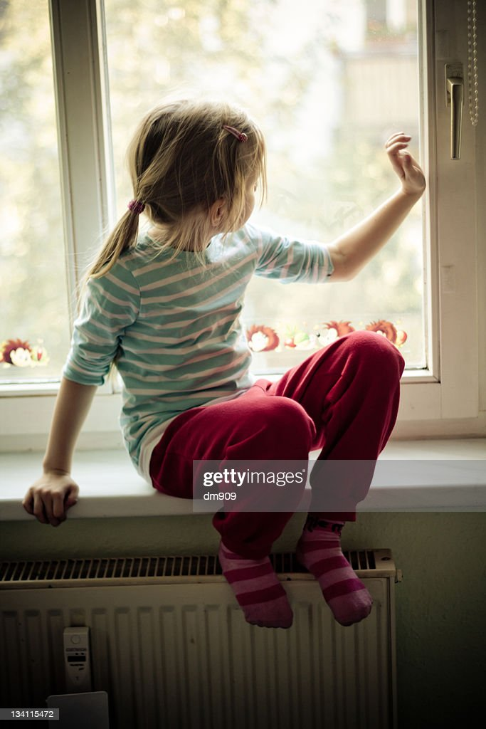 Girl Sitting On Window Board Stock Photo Getty Images