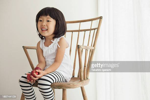 Girl sitting on wooden chair,  portrait