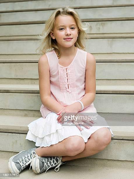 Girl sitting on wooden steps, portrait
