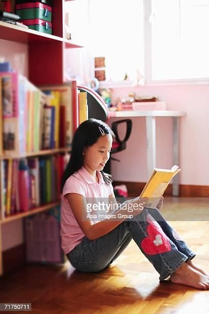 Girl sitting, reading book
