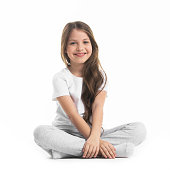 Portrait of small girl sitting turkish isolated on white background