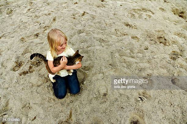 Girl sitting with little kitty