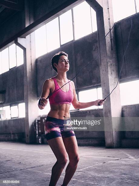 Girl skipping with a jump rope for exercise