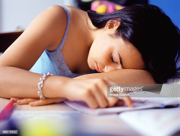 Girl sleeping at desk