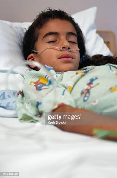 Girl Sleeping in a Hospital Bed