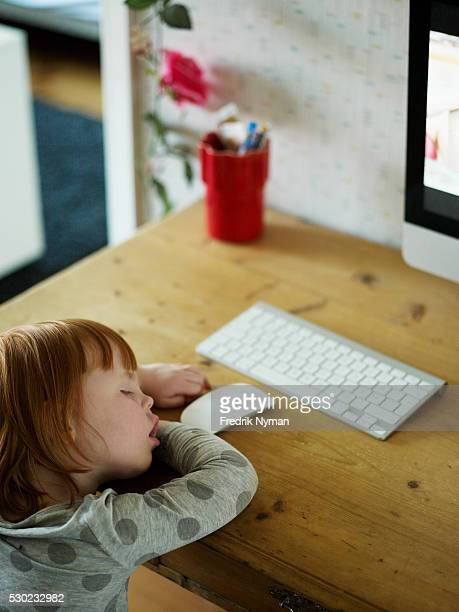 Girl sleeping in front of computer