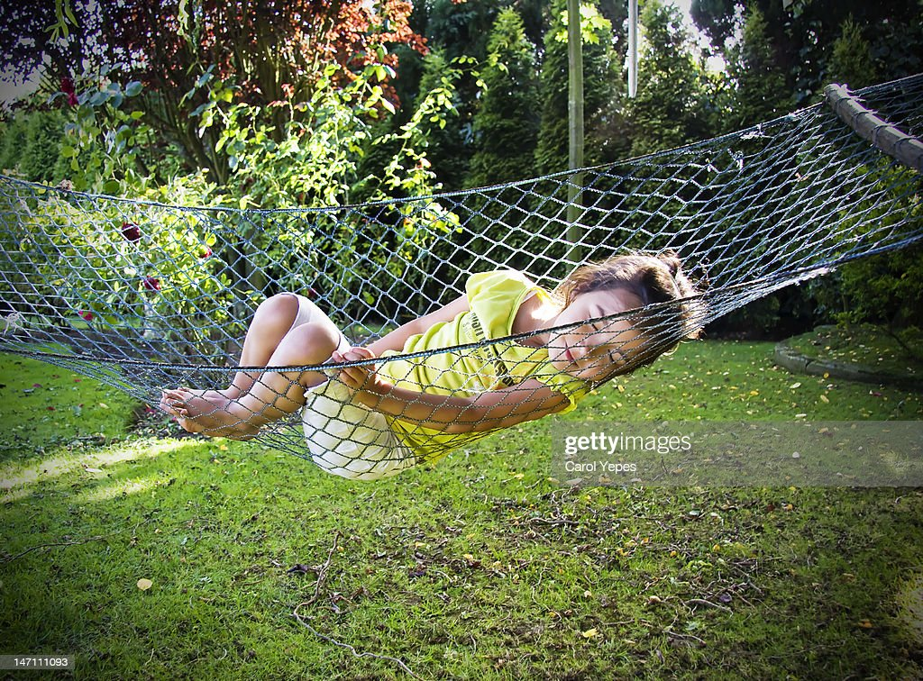 Girl sleeping on swing : Stock Photo