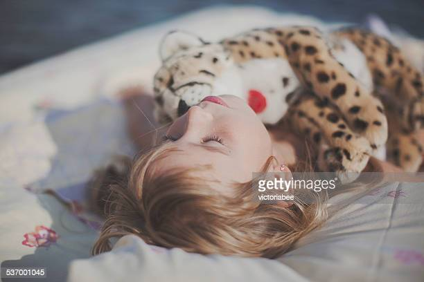 Girl sleeping with a soft toy
