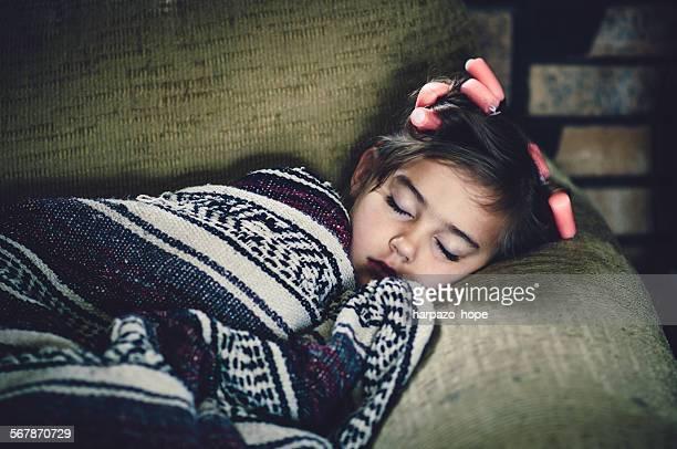 Girl sleeping with curlers
