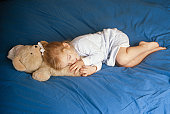 Girl (4-5) sleeping with thumb in mouth
