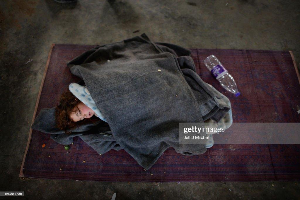 ZA'ATARI JORDAN JANUARY 30 A girl sleeps as new Syrian refugees arrive at the International Organization for Migration at the Za'atari refugee camp...