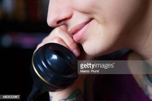 Girl smile at the phone : Stock Photo