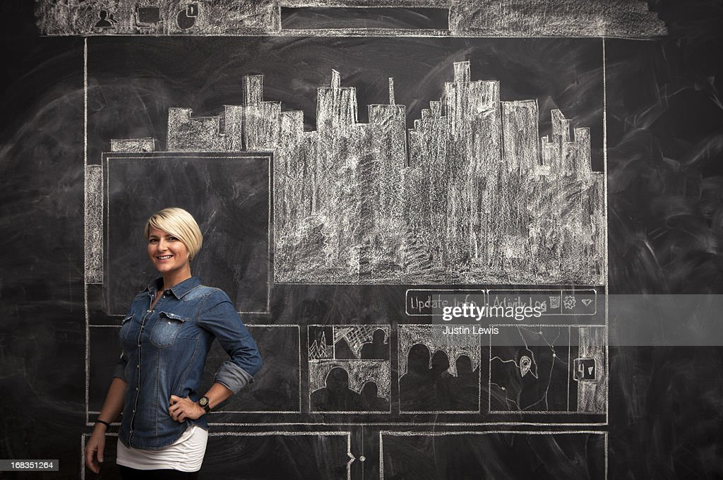 Girl smiles in front of chalkboard facebook page : Stock Photo