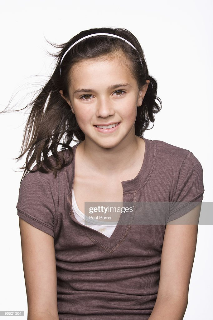 Girl smiling and hair flying in the air : Stock Photo