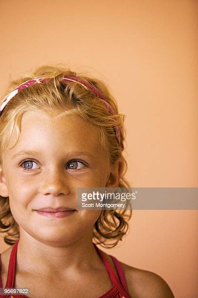 Girl smiling and looking away