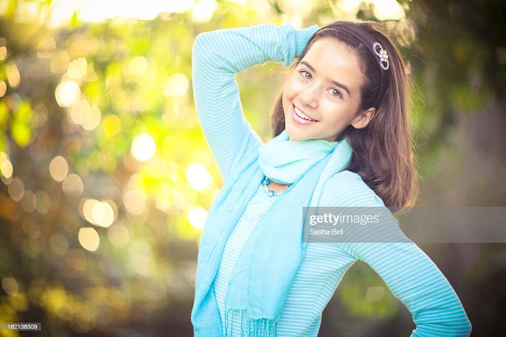Girl smiling at camera : Stock Photo
