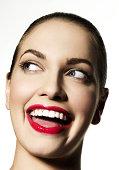 Girl smiling at someone off camera