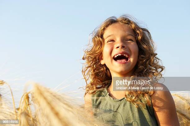 Girl smiling in a wheat field
