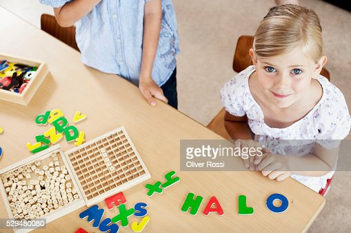 Girl smiling in classroom : Stock Photo