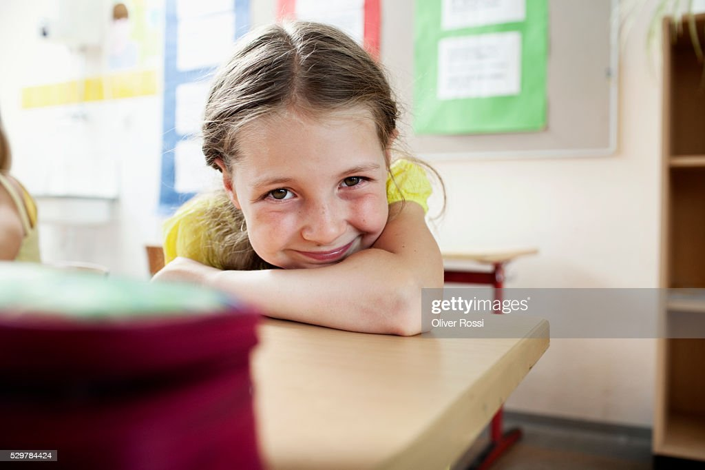 Girl smiling in classroom : Stockfoto
