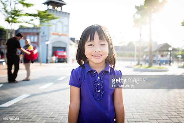 Girl smiling in the sunshine