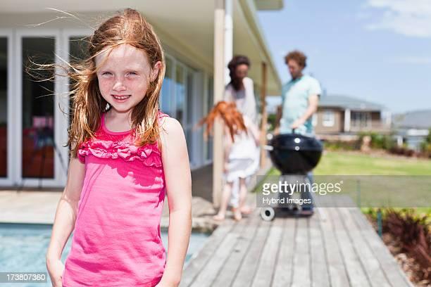 Girl smiling on backyard patio