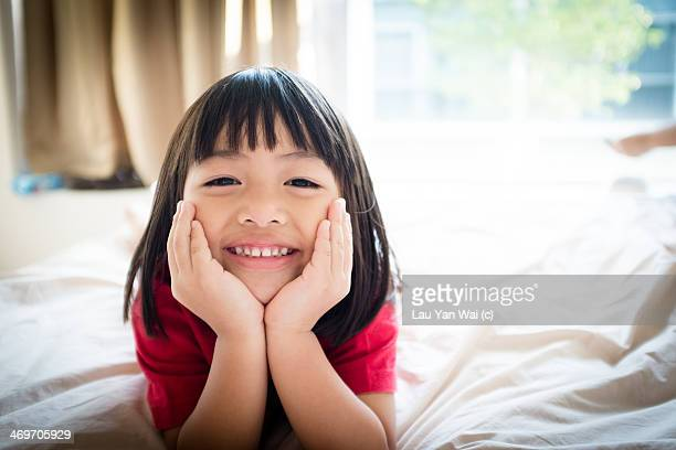 Girl smiling on bed