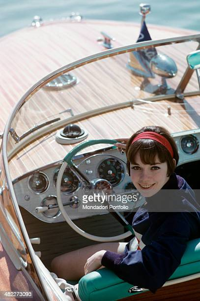 A girl smiling on the Super Florida motorboat made by Riva shipyard 1960s