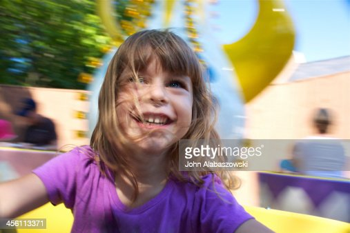Girl smiling on the tea cup ride