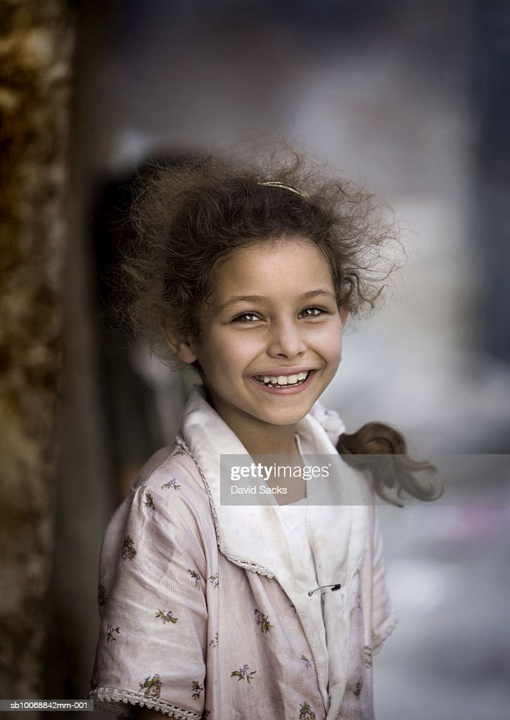 Girl (6-7) smiling outdoors, portrait : Stock Photo
