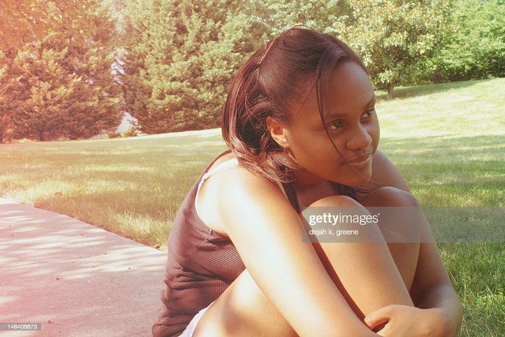 Girl smiling outside : Stock Photo