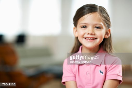 Girl (4-6) smiling, portrait, close-up : Stock Photo