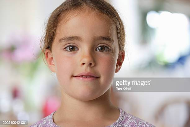 Girl (7-9) smiling, protrait, close-up