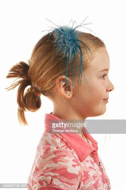 Girl (8-10) smiling, side view