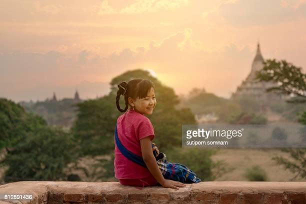Girl smiling sitting on the pagoda